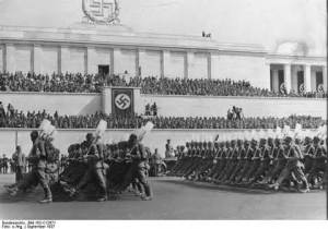 Adolf Hitler reviewing a Reich Labour Service (RAD) parade, Zeppelin Field, Nürnberg, Germany, Sep 1937. Picture courtesy of ww2db.com